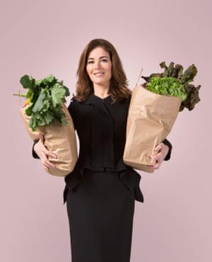Nigella Lawson with two shopping bags filled with veg