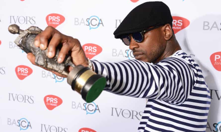 Skepta poses with his songwriter of the year award
