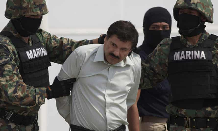 Joaquín 'El Chapo' Guzmán is escorted to a helicopter in Mexico City, Mexico on 22 February 2014.
