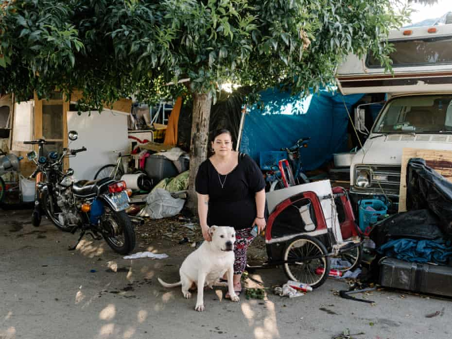 Nicole Burns lives with her dog Angel in an encampment near the new Square building.