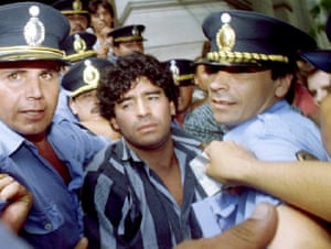 Maradona, escorted by police, leaves a courthouse in March 1994 after answering charges he shot and injured journalists outside his country home in the city of Mercedes, 100km from Buenos Aires