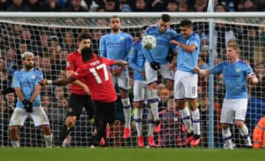 Fred drives the ball into the wall.