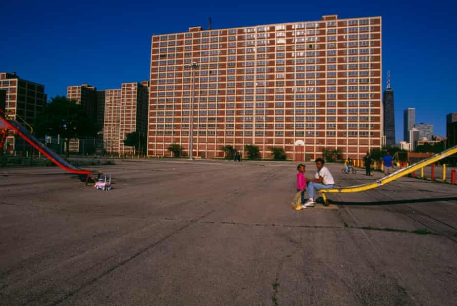 Children play on slides outside the Cabrini-Green housing project in Chicago.