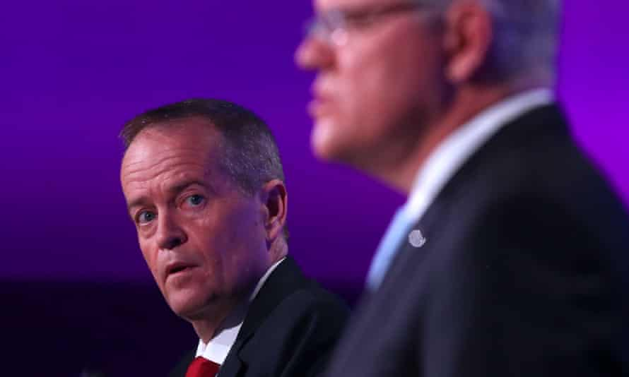 Bill Shorten looks at Scott Morrison during the leaders' final election debate in Canberra.