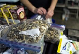 A vendor bags psilocybin mushrooms at a pop-up cannabis market in Los Angeles.