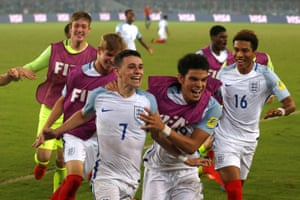 England's Philip Foden celebrates scoring his second goal with team-mates.
