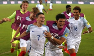 Phil Foden celebrates with England teammates after scoring the last goal in the 5-2 win against Spain in the Under-17 World Cup final in 2017