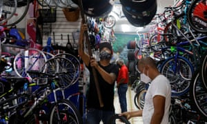 A man looks at bicycle parts inside a shop as the Covid-19 outbreak continues in Mexico City.