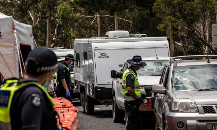Police at a border checkpoint in Mallacoota, Australia, December 2020