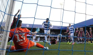 Queens Park Rangers' Nahki Wells slots the ball home to open the scoring.