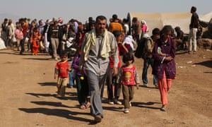 Displaced Iraqi Yazidis at a refugee camp in Syria
