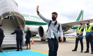 Lorenzo Insigne of Italy arrives with his teammates at Luton airport.