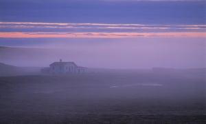 'Dusk is drawn' ... sunset over an isolated farmhouse.