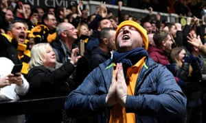Newport County fans celebrate Amonds goal and pray for a second one.