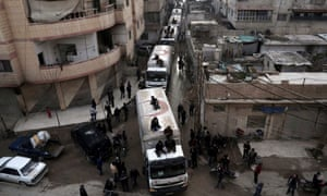 A Red Crescent convoy carrying humanitarian aid arrives in Kafr Batna, on the outskirts of the capital Damascus.