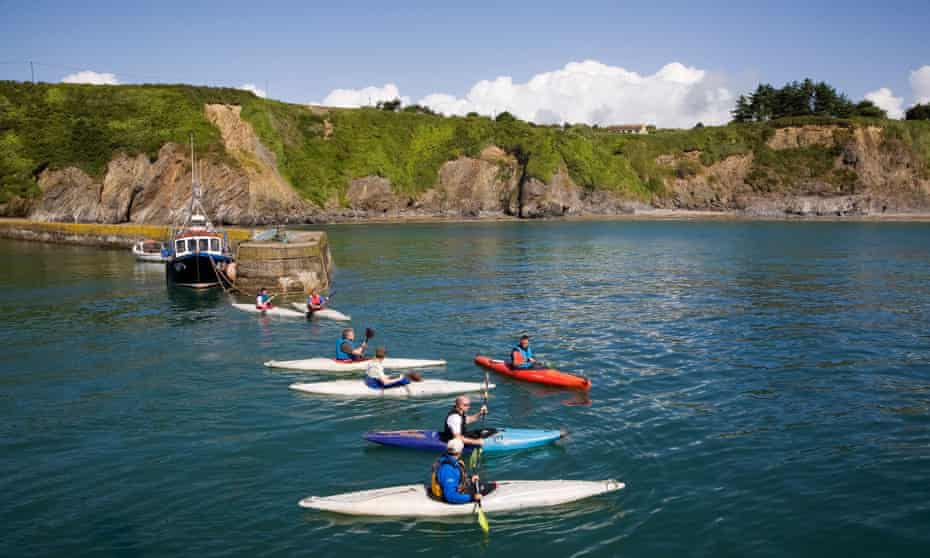 Kayaks in the harbour at Boatstrand, Copper Coast, County Waterford.