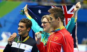 Australia's Mack Horton, centre, celebrates his victory in the 400m freestyle over Sun Yang of China, right, and Gabriele Detti of Italy, who won bronze.