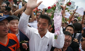 Thanathorn Juangroongruangkit, the leader of the pro-democracy Future Forward party, greets supporters as he arrives at a police station to hear a sedition complaint filed by the army last month