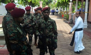 Military personnel stand guard outside St Sebastian's Church in Negombo.
