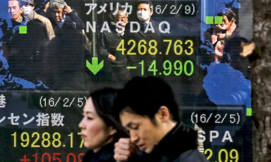 A ticker shows Japanese stocks taking another nosedive on Wednesday, falling below the 16,000 line to a roughly 15-month intraday low.