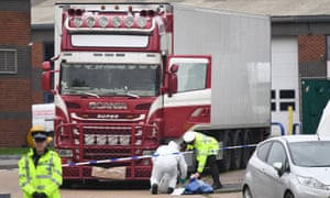 Police and forensic officers examining the lorry