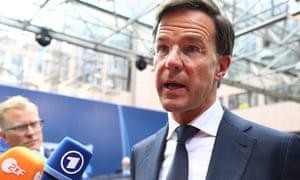 Mark Rutte speaks to journalists as he arrives in Brussels.