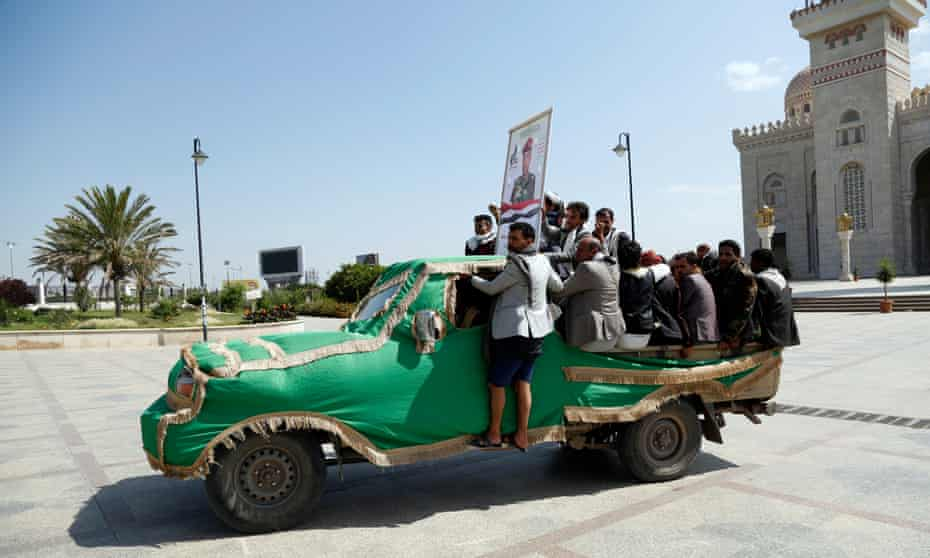 Houthi followers ride trucks carrying the coffins of fighters who were killed in recently intensified fighting, during a funeral in Sana'a, Yemen.