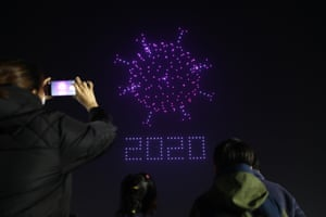 Seoul, South Korea  Drones flying over the Olympic Park make the shape of coronavirus to send messages to support the country and share measures to contain its spread
