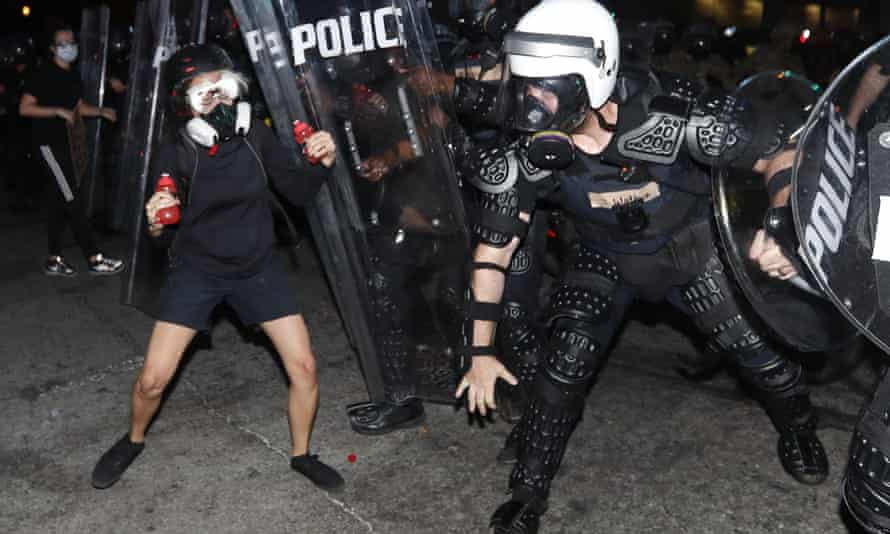 Atlanta police clash with a demonstrator during a protest on 2 June in Atlanta.