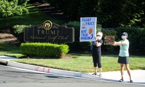 Demonstrators gather outside Trump National Golf Club on Saturday in Sterling, Virginia.