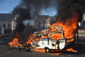 A caravan burns during a protest in Le Mans, France