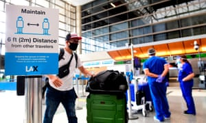 Passengers at LAX airport on Tuesday. The US has had more than 2.3 million confirmed cases and more than 121,000 deaths since the pandemic began.