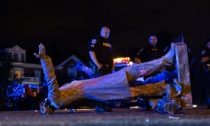 The toppled statue of Confederate States President Jefferson Davis lies on the street after protesters pulled it down in Richmond, Virginia, on 10 June.