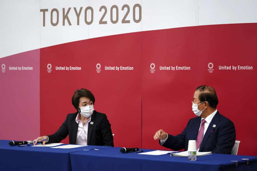 Seiko Hashimoto, the new Games chief, and Toshiro Muto, the Games CEO, speak at a news conference on Thursday