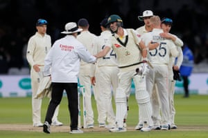 Cummins shakes hands with the umpire as the match is drawn.