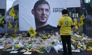 A fan stands at a shrine to Emiliano Sala