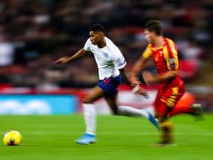 Marcus Rashford from England passes Montenegro's Nikola Vukcevic