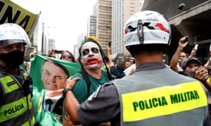 Demonstrators protest against the closure of businesses due to the pandemic in Sao Paulo, Brazil, 14 March 2021.