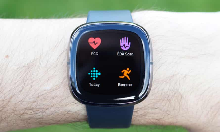 Fitbit Sense on wrist showing apps