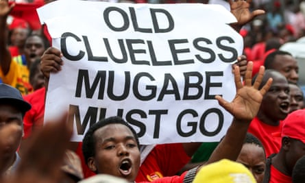 MDC-T youth supporters hold up a sign during the protest.
