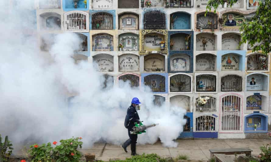 A specialist fumigates the Nueva Esperanza graveyard in the outskirts of Lima. Cases of the zika virus are being linked to the potentially-fatal Guillain-Barre condition.