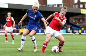 Kim Little of Arsenal keeps ahead of Millie Bright of Chelsea.