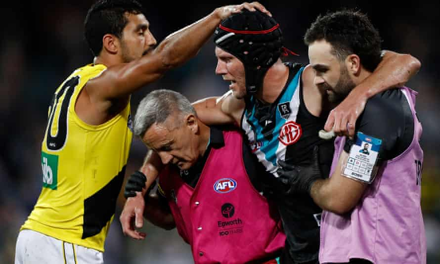 Marlion Pickett of Richmond Tigers acknowledges Port Adelaide Power's Brad Ebert as Ebert is taken from the ground after suffering a concussion in Adelaide in October.