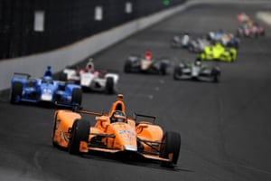 Fernando Alonso, in his McLaren-Honda-Andretti Honda, leads a pack of cars during the 101st Indianapolis 500 in 2017.
