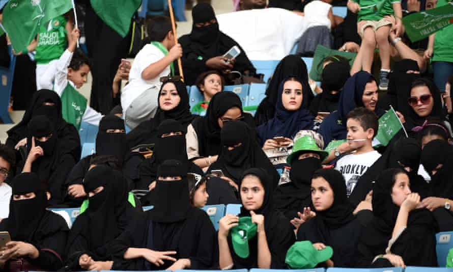 Saudi women sit for the first time in the King Fahd stadium as the country celebrated national day on 23 September.