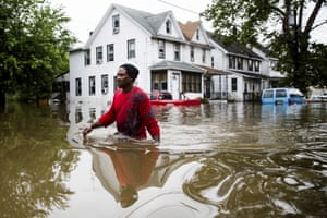 Chris Smith makes his way through floodwaters to the Macedonia Baptist church.