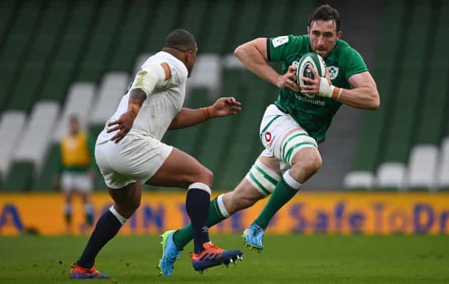 Jack Conan, one of the Ireland try-scorers, makes a powerful run up against the England prop Kyle Sinckler.