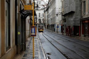 A tram drives along an empty street in downtown Lisbon, in this picture taken last week