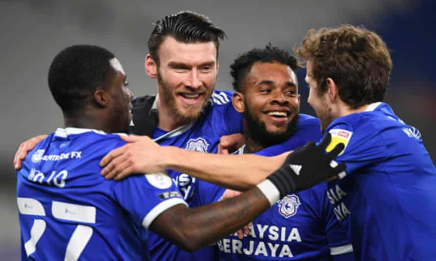 Leandro Bacuna (second right) celebrates with his Cardiff teammates after scoring his second goal.