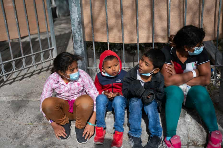 Four children sit on the streets of Ciudad Juárez after being deported from the US.